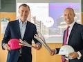 Ganzheitlich FTTH für Münster: Michael Hagspihl (Deutsche Telekom) und Sebastian Jurczyk (Stadtwerke Münster)