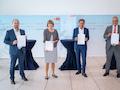 Von links: Matthias Mause (Vantage Towers), Henriette Reker (Oberbürgermeisterin), Gerhard Mack (Vodafone), Dieter Steinkamp (Stadtwerke Köln)
